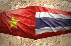 Vietnam and Thailand. Waving Vietnamese and Thai flags on the background of the political map of the world Royalty Free Stock Photography