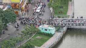 Vietnam traffic. Aerial traffic view of rooftop skyscraper on Nhieu Loc canal in Ho Chi Minh city, Vietnam stock video