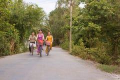 Three womens on bikes in vietnam Stock Photo