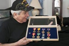 Vietnam vet looks over his medals Stock Images