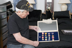 Vietnam vet looks over his medals Royalty Free Stock Photography