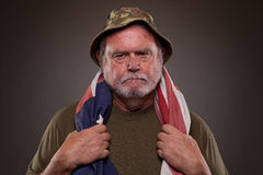 Vietnam Veteran with American flag Stock Photo