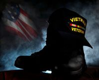 Vietnam Veteran. Cap on combat boots in silhouette to remember the vets Royalty Free Stock Photography