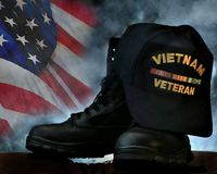 Vietnam Veteran. Cap on combat boots in silhouette to remember the vets stock images