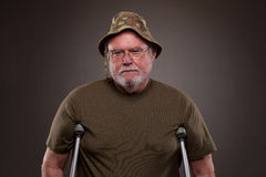Vietnam Veteran with crutches. Vietnam Veteran standing with the help of crutches Stock Photography