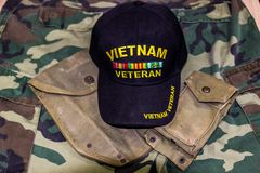 Vietnam Veteran Hat & Pouches On Camoulage Uniform. Vietnam Veteran Hat With Service Pouches On Camouflage Jungle Greens Uniform Stock Photography