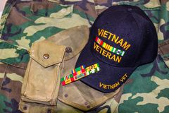 Vietnam Veteran Hat, Ribbons & Weathered Pouches. Vietnam Veteran Hat, Service Ribbons And Actual Weathered In Country Pouches Royalty Free Stock Photo