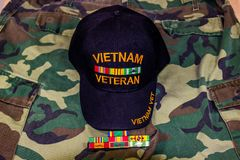 Vietnam Veteran Hat With Service Ribbons On Camouflage Uniform. Vietnam Veteran Hat With Service Ribbons On Jungle Greens Camouflage Uniform Royalty Free Stock Photos