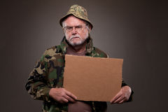 Vietnam Veteran holding a cardboard piece Royalty Free Stock Photo