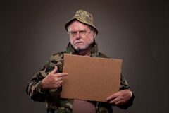 Vietnam Veteran showing a cardboard piece Royalty Free Stock Photos