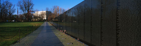 Vietnam Veterans Memorial. This is the Vietnam Veterans Memorial known as the Wall. A sidewalk leads to the Lincoln Memorial. there are a few small American Royalty Free Stock Photo