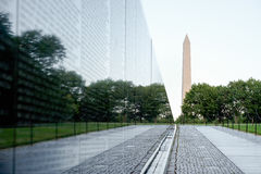 The Vietnam Veterans Memorial in Washington D.C. With the Washington Monument on the background Stock Photos