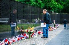 Vietnam Veterans Memorial in Washington DC, USA. WASHINGTON, D.C. - MAY 27, 2013: People visit and lay flowers at the Vietnam Veterans Memorial on May 27, 2013 Stock Photography