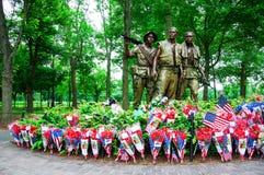 Vietnam Veterans Memorial in Washington DC, USA. WASHINGTON, D.C. - MAY 27, 2013: People visit and lay flowers at the Vietnam Veterans Memorial on May 27, 2013 Stock Images
