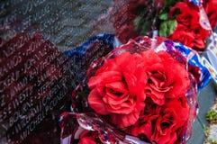 Vietnam Veterans Memorial in Washington DC, USA. WASHINGTON, D.C. - MAY 27, 2013: People visit and lay flowers at the Vietnam Veterans Memorial on May 27, 2013 Royalty Free Stock Image