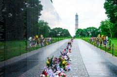 Vietnam Veterans Memorial in Washington DC, USA. WASHINGTON, D.C. - MAY 27, 2013: People visit and lay flowers at the Vietnam Veterans Memorial on May 27, 2013 Stock Image