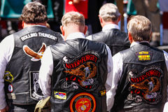 Vietnam Veterans - Never Forget. Several members of the Rolling Thunder, Inc. and Patriot Guard Riders bow their heads in prayer during a parade honoring SFC Stock Photos