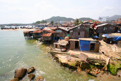 Vietnam View. Poor housing along a river bank in Vietnam Royalty Free Stock Photography