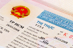 Vietnam visa in passport. Vietnam visa label with emblem in passport Stock Photo