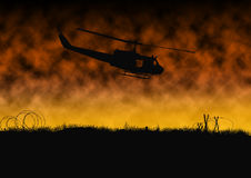 Vietnam War - Artist recreation. Silhouette of American helicopter on patrol in the rice paddies and jungle of Vietnam. Artist illustration Royalty Free Stock Images