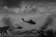 Vietnam War - Artist recreation. Vietnam War 'style' B&W image circa 1968 of two helicopter gunships flying low over the jungle of South Vietnam looking for Viet Stock Photography