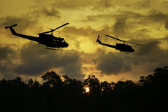 Vietnam War - Artist recreation. Vietnam War 'style' image circa 1970 three helicopters flying over South Vietnam looking for the North Vietnamese Army. (Artist' Stock Photos