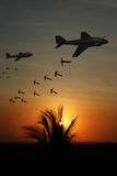 Vietnam War - Artist recreation. Vietnam War 'style' image circa 1970 of two Intruder fighter bombers flying low over South Vietnam at sunest/sunrise unloading Stock Photography