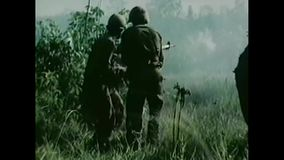 Vietnam War – 1965 - 101st Airborne Division during a battle. Vietnam War. US Army. US Army Airborne soldiers are in a battle against vietcong in the Vietnam stock video
