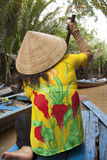 Vietnam woman paddles a boat, Mekong River Stock Photography