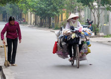Vietnam woman riding bicycle Royalty Free Stock Images