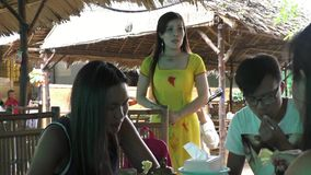 Vietnam woman singer performing in a restaurant stock video footage