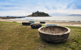 Vietnam woven bamboo basket boats on the beach. Royalty Free Stock Images