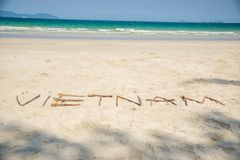 Vietnam written in a sandy tropical beach Stock Image