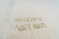 Vietname bem-vindo escrito na areia Fotografia de Stock Royalty Free