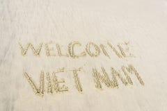 Vietname bem-vindo escrito na areia Fotografia de Stock