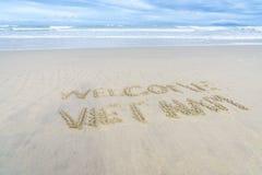 Vietname bem-vindo escrito na areia Fotos de Stock
