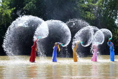 Vietnames women in traditional dress. Group of Vietnamese women in traditional dress playing in a river Stock Image