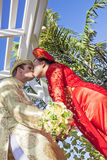 Vietnamese American wedding couple kiss Stock Images