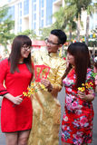 VIETNAMESE AO DAI. Boys and Grils wear traditional Ao Dai dress in lunar new year at Viet Nam Stock Photos