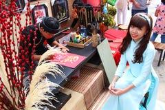 VIETNAMESE AO DAI. Grils wear traditional Ao Dai dress in lunar new year at Viet Nam Stock Photo