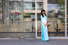 VIETNAMESE AO DAI. Grils wear traditional Ao Dai dress in lunar new year at Viet Nam Stock Image