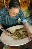Vietnamese artist wood engraving, Genh Rang Stock Image