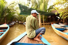 Vietnamese asian man rawing canoe boat Royalty Free Stock Images