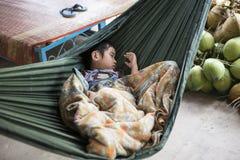 Vietnamese baby sleeping, Vietnam. Vietnamese baby sleeping in a hammock, Vietnam Royalty Free Stock Image