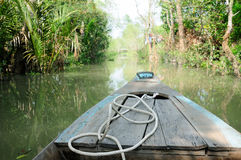 Vietnamese Bamboo Boat. The front of Vietnamese bamboo boat floating in the Mekong River delta in Vinhlong Vietnam Royalty Free Stock Image