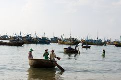 Vietnamese  with basket boat Royalty Free Stock Photos