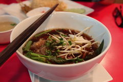 Vietnamese beef noodle soup called pho. With green onion, bean sprouts and chili Stock Images