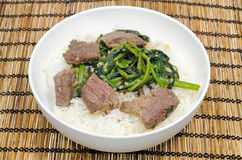 Vietnamese Beef Stir Fried With Water Spinach. / Morning Glory Vegetable served with steamed rice Royalty Free Stock Photos