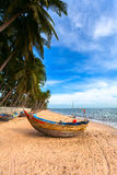 The Vietnamese boat on a sea beach Stock Image