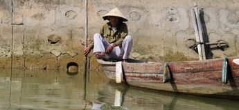 Vietnamese boatman stock photo